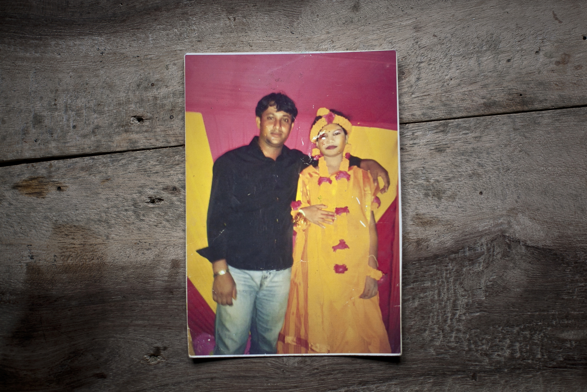 14 year old Shima Akhter is seen in a photograph with her uncle on the night of her holud ceremony.  Last year, when she was 13, Shima married an 18 year old man.