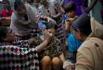 15 year old Nasoin Akhter is bathed on the day of her wedding to a 32 year old man in Manikganj, Bangladesh.