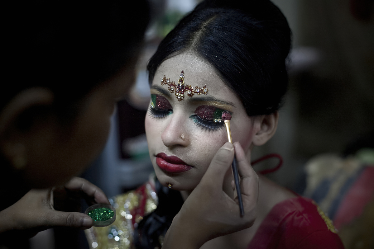 15 year old Nasoin Akhter has her makeup done at a beauty parlour on the day of her wedding to a 32 year old man,