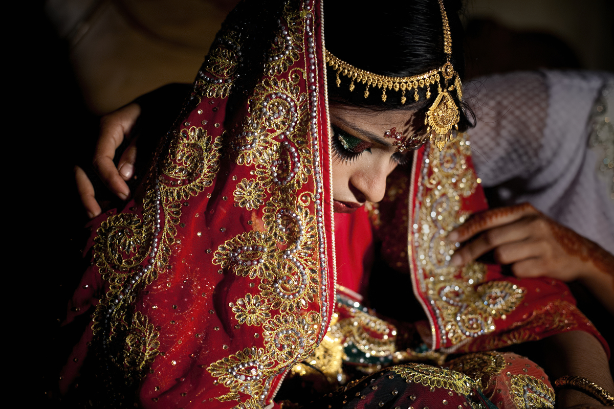 15 year old Nasoin Akhter is consoled by a friend on the day of her wedding to a 32 year old man