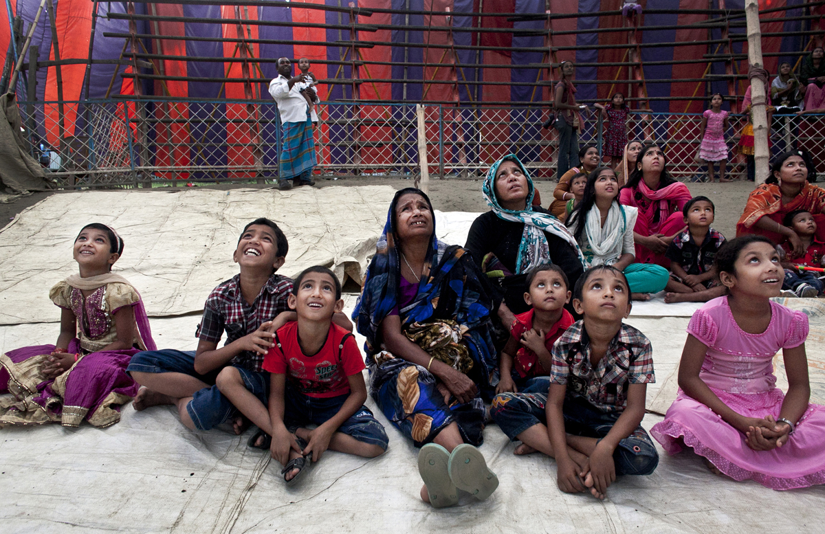 Women and children watch a performance at the Olympic Circus.