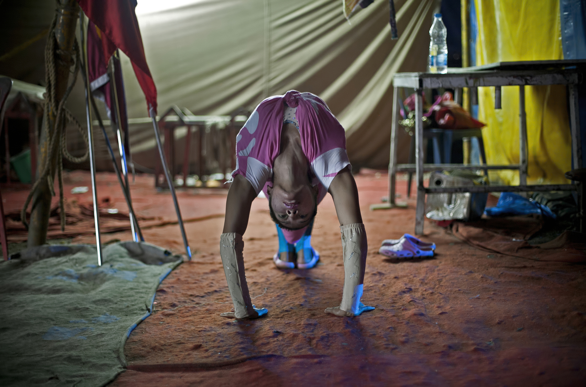 A performer practices backstage before a show