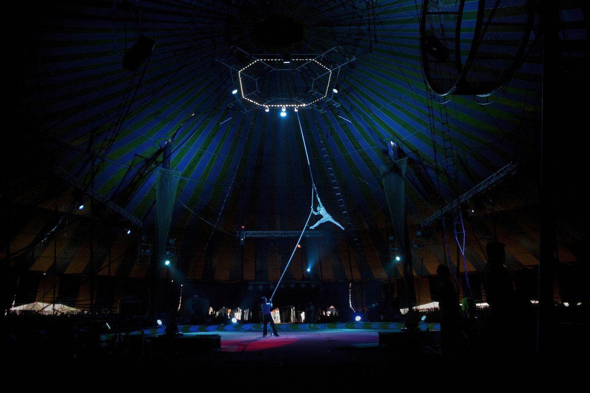 Circus workers perform during a show