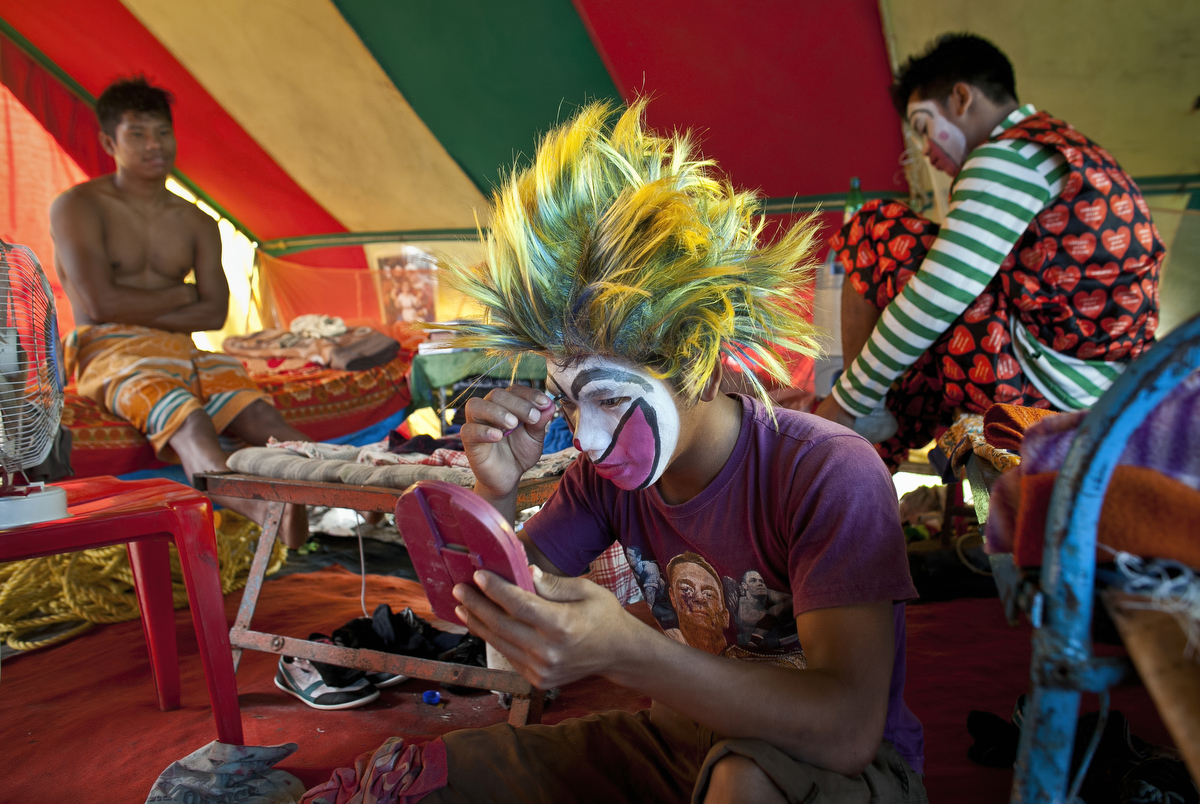 Circus workers prepare before a show