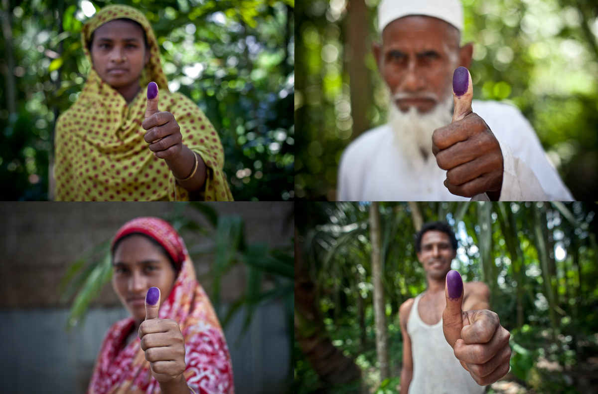 Bash Kata Indian enclave residents pose for a photo after voting to choose their citizenship with Enclaves Exchange Coordination Committee in Lalmonirhat District, Bangladesh.
