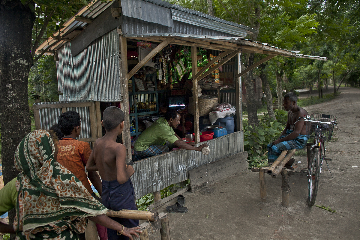 People watch TV at a shop in the Bash Kata Indian enclave in Lalmonirhat District, Bangladesh.