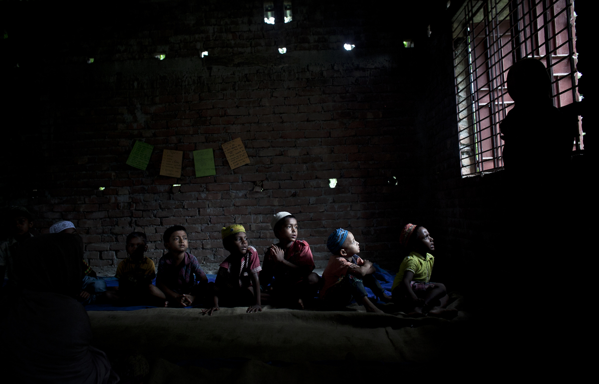 Children attend an Islamic school in a mosque in the Bash Kata Indian enclave in Lalmonirhat District, Bangladesh.