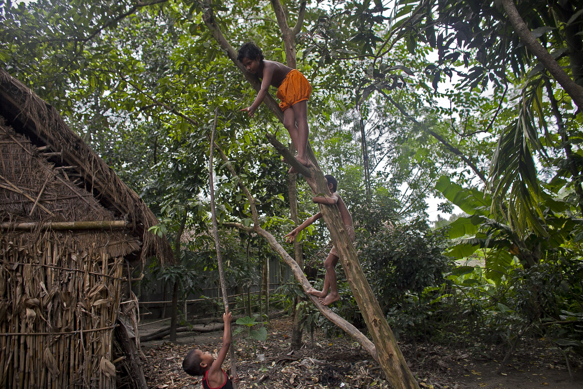 Children play in the Bash Kata Indian enclave in Lalmonirhat District, Bangladesh.