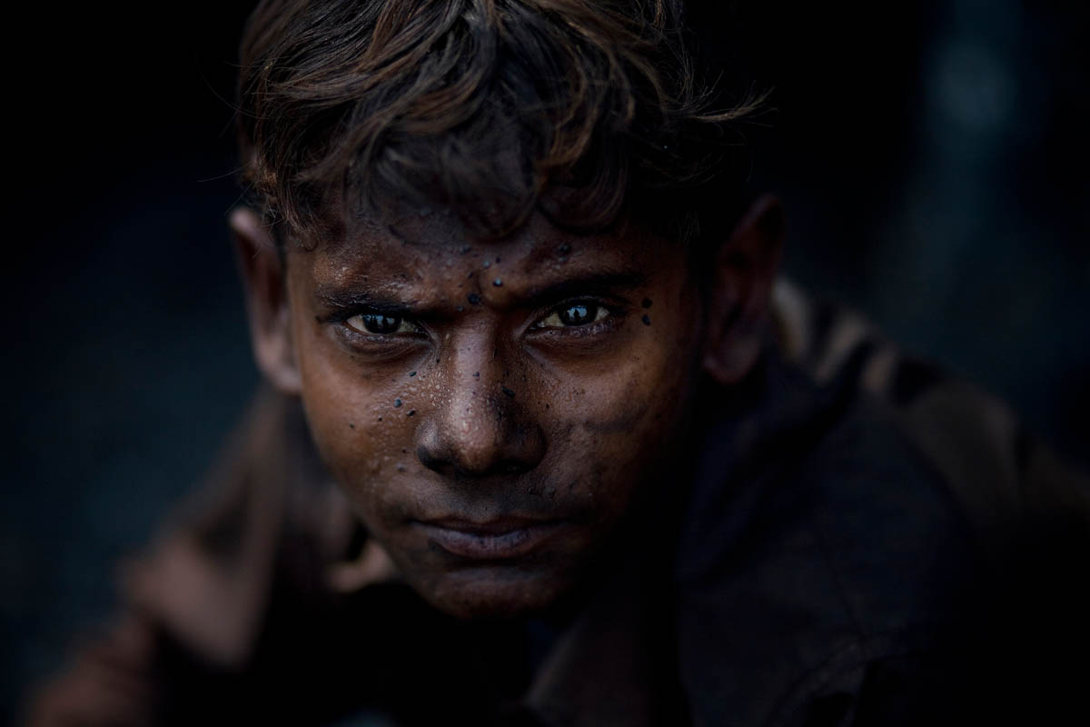 A young child collects coal illegally from Bagdigi mine in Jharia. In 2001, 28 miners died in Bagdigi mine when 16 million gallons of water rushed in and trapped the miners.