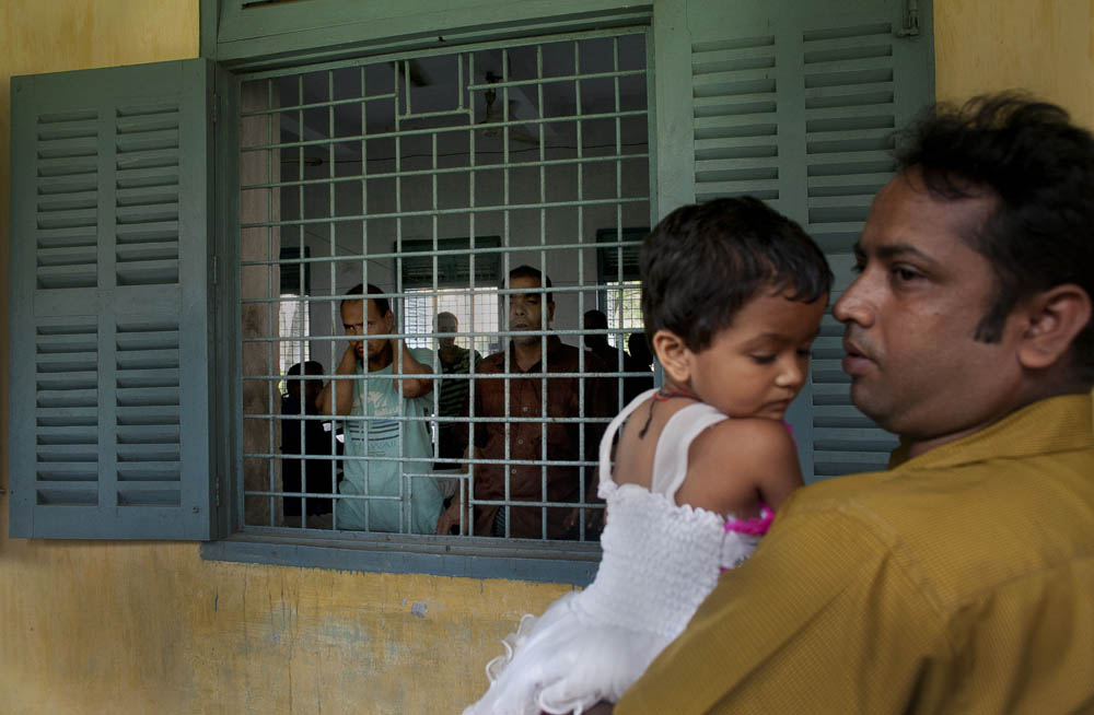 A tourist and his daughter visit Pabna Mental Hospital August 20, 2014 in Pabna, Bangladesh. After the doctors leave for the day it is common to see normal Bangladeshis touring the wards of the hospital. Mental health in Bangladesh is largely neglected and under financed, and the stigma of mental health is huge. In rural areas there are few doctors and families generally take the patient to a traditional healer first, who usually tries to exorcize the Jinn (spirits) with holy water and versus from the Koran. Families who have a mentally ill family member sometimes tie them up out of desperation and lack of education and options. There is only one government run mental hospital with 500 beds in the entire country. Less than 0.5% of government health budget is spent for mental health. Allison Joyce/Redux