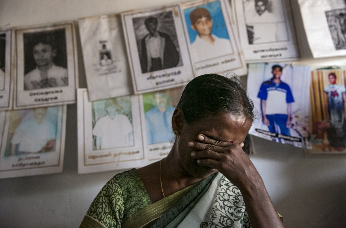Thagbsiwaran Sivaganawathy cries while discussing the disappearance of her daughter, Thageswaran Susanya, at a protest site for loved ones of the disappeared in Mullaitivu, Sri Lanka. Thagbsiwaran Sivaganawathys daughter, Thageswaran Susanya, has been missing since March 14 2009. They were at their home when military surrounded the village and bombs were dropped from airplanes. They all fled and in the chaos got separated, and Sivaganawathy hasnt seen her daughter since. Sivaganawathys husband is so depressed he cant work or leave the house sometimes. She has searched all over and filed complaints with the ICRC and police, but hasn't found any news. She comes to this protest site 3 times a week demanding for the release of her daughter.