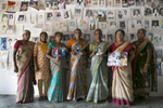 Women pose for a photo at a protest site for loved ones of the disappeared in Mullaitivu, Sri Lanka