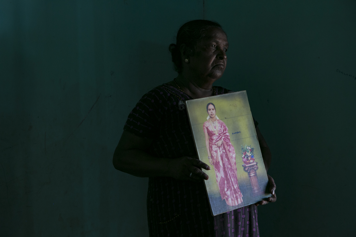 Arumugam Antonyka holds a photo of her daughter, Diana Arumugam in Mullaitivu, Sri Lanka. Arumugam Antonykas daughter, Diana Arumugam, has been missing since 2010. They were living together in a refugee camp with her 3 kids. Diana called her as she was traveling on the bus back from work to say that she was coming home, but she never returned. {quote}Every day I pray that she comes back home. I'm sure she's alive.{quote}