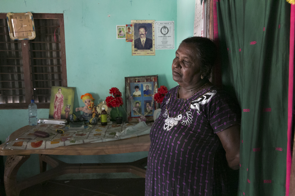Arumugam Antonyka stands in her home in Mullaitivu, Sri Lanka. Arumugam Antonykas daughter, Diana Arumugam, has been missing since 2010. They were living together in a refugee camp with her 3 kids. Diana called her as she was traveling on the bus back from work to say that she was coming home, but she never returned. {quote}Every day I pray that she comes back home. I'm sure she's alive.{quote}