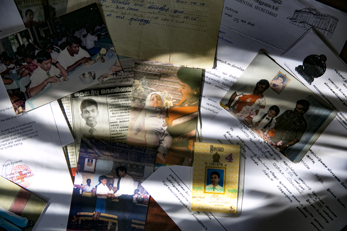 Photos and documents related to the disappearance of Sujeekaran are seen in Mullaitivu, Sri Lanka. Ranchana Pirapakarado has been missing her son, Sujeekaran, since May 23, 2009 when they got separated at a government checkpoint while being transferred from a refugee camp. Afterwards, she searched all the 23 refugee camps across the country and military bases and couldn't find him. In 2014 she got a call from the Terrorist Information Camp who said her son was in Colombo. She answered his questions on the promise that her son would be freed but he never was.