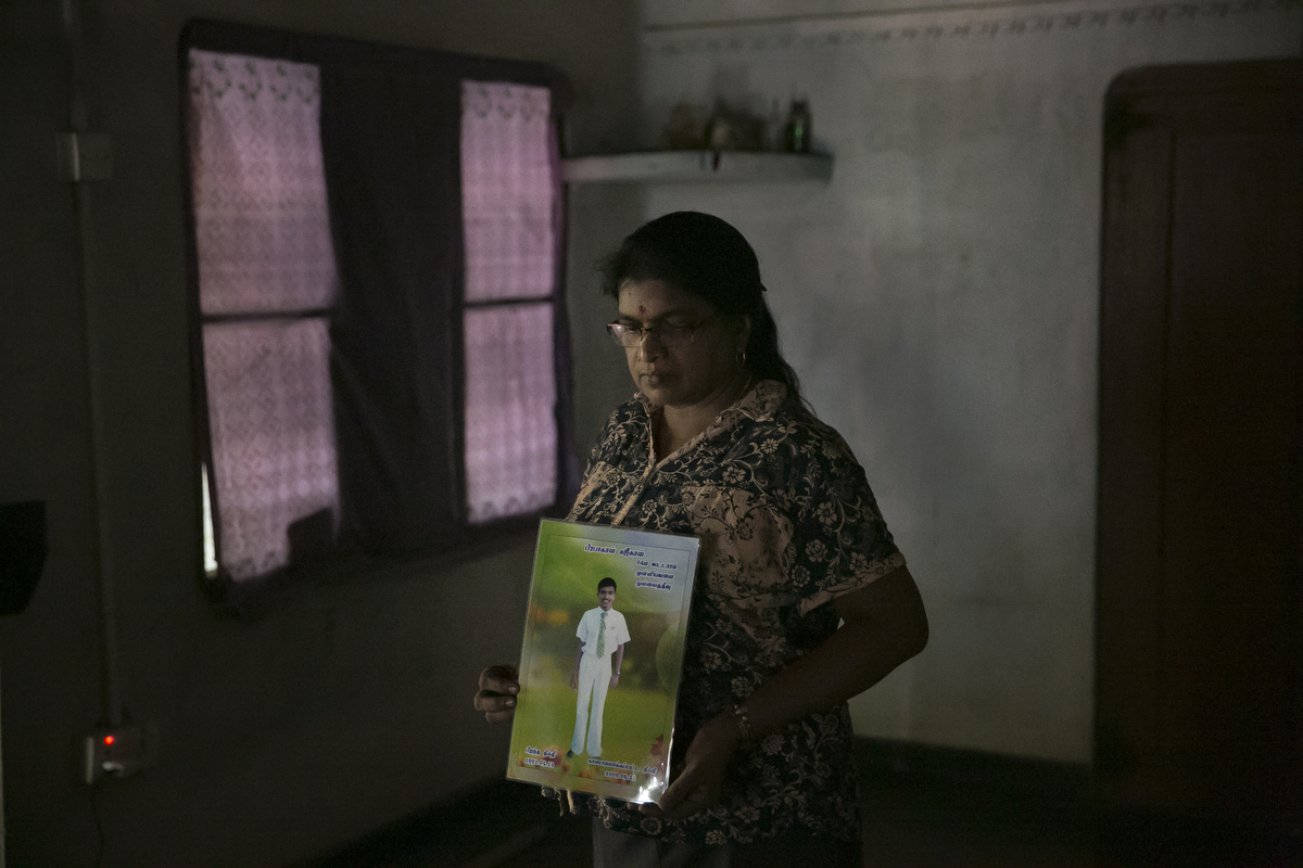 Ranchana Pirapakarado holds a photo of her of her son, Sujeekaran in Mullaitivu, Sri Lanka. Ranchana Pirapakarado has been missing her son, Sujeekaran, since May 23, 2009 when they got separated at a government checkpoint while being transferred from a refugee camp. Afterwards, she searched all the 23 refugee camps across the country and military bases and couldn't find him. In 2014 she got a call from the Terrorist Information Camp who said her son was in Colombo. She answered his questions on the promise that her son would be freed but he never was.