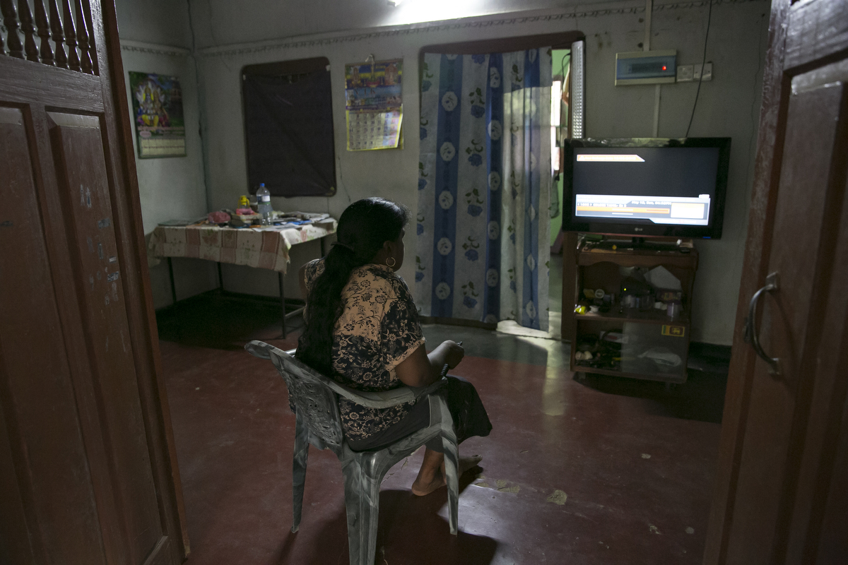 Ranchana Pirapakarado watches TV at her home in Mullaitivu, Sri Lanka. Ranchana Pirapakarado has been missing her son, Sujeekaran, since May 23, 2009 when they got separated at a government checkpoint while being transferred from a refugee camp. Afterwards, she searched all the 23 refugee camps across the country and military bases and couldn't find him. In 2014 she got a call from the Terrorist Information Camp who said her son was in Colombo. She answered his questions on the promise that her son would be freed but he never was.S