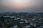 COX'S BAZAR, BANGLADESH - JANUARY 12: The sun sets over Balukhali camp on January 12, 2018 in Cox's Bazar, Bangladesh. Over 650,000 Rohingya have crossed the border to Bangladesh since August last year, fleeing the violence at Rakhine State when their villages were attacked and many worry that they will face further reprisals if they return to Myanmar. The refugee camps in Bangladesh no longer seem temporary as thousands of tents made of plastic and bamboo spread across the undulating terrain and long wooden bridges connect parts of the camps divided by water. Existing camps such as Nayapara and Kutupalong have swelled to accommodate the new arrivals since the Myanmar military began its campaign in late August while the Rohingya queue for hours to get rations due to little access to clean water, health care or food and the refugee camps turn into mud-baths whenever it rains. International aid groups and health workers have estimated at least 6,700 Rohingya had met with violent deaths and warn of potential outbreaks of cholera and other preventable diseases due to squalid conditions. (Photo by Allison Joyce/Getty Images)
