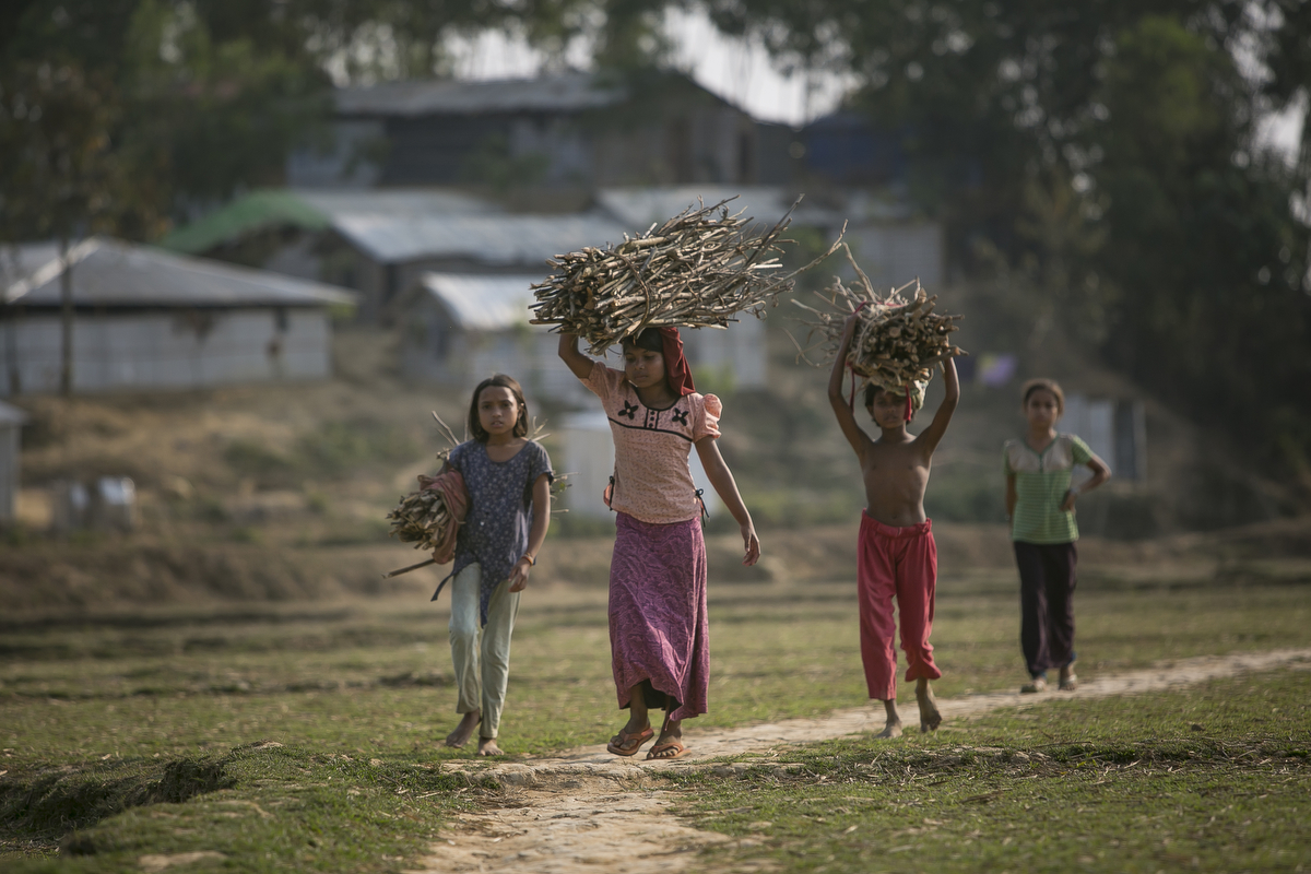 Girls carry firewood in Balukhali camp March 5, 2018 in Cox's Bazar, Bangladesh. Photo by Allison Joyce for UN Women