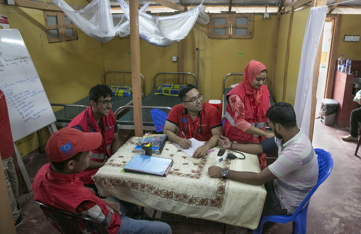 Staff works at the PHCC October 1, 2018 in the Rohingya refugee camp in Cox's Bazar, Bangladesh. The 20 bed Primary Health Care Centre has a structure that includes a maternity unity, a pharmacy, separate buildings for triage, inpatients and outpatients, and its own water tower and generator. The centre is the only one in the area to provide 24/7 in-patient care and will serve a population of 20,000 people, both Rohingya refugees and host community. The centre runs 24 hours 7 days a week, and is also accessible for ambulances, which bring patients referred from facilities without capacity to keep patients overnight.
