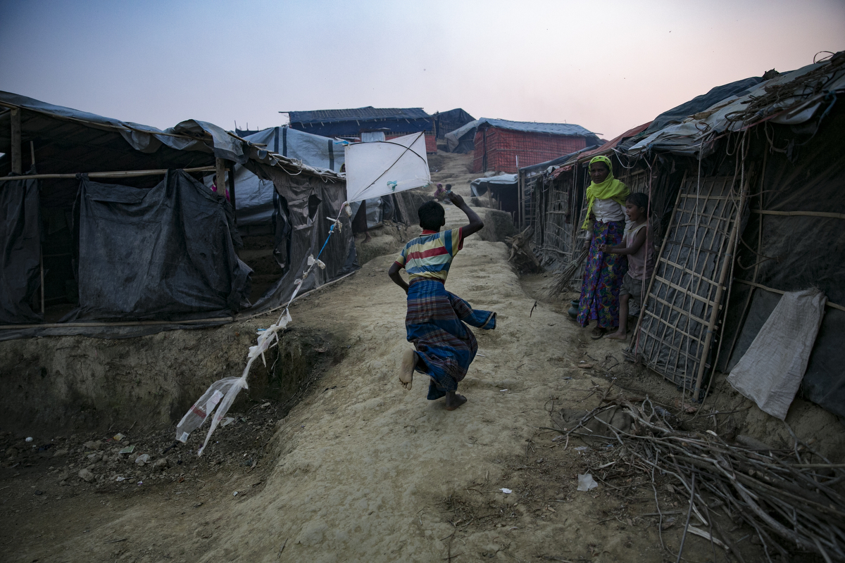 COX'S BAZAR, BANGLADESH - JANUARY 12: Rohingya refugees are seen in Balukhali camp on January 12, 2018 in Cox's Bazar, Bangladesh. Over 650,000 Rohingya have crossed the border to Bangladesh since August last year, fleeing the violence at Rakhine State when their villages were attacked and many worry that they will face further reprisals if they return to Myanmar. The refugee camps in Bangladesh no longer seem temporary as thousands of tents made of plastic and bamboo spread across the undulating terrain and long wooden bridges connect parts of the camps divided by water. Existing camps such as Nayapara and Kutupalong have swelled to accommodate the new arrivals since the Myanmar military began its campaign in late August while the Rohingya queue for hours to get rations due to little access to clean water, health care or food and the refugee camps turn into mud-baths whenever it rains. International aid groups and health workers have estimated at least 6,700 Rohingya had met with violent deaths and warn of potential outbreaks of cholera and other preventable diseases due to squalid conditions. (Photo by Allison Joyce/Getty Images)