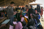 Women are seen at an ACF donation point In Balukhali Rohingya Refugee camp February 1, 2018 in Chittagong district, Bangladesh. UN Women/Allison Joyce