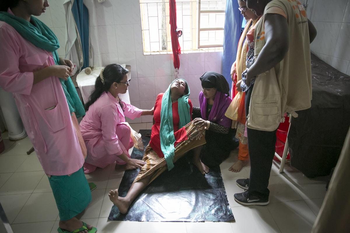 Salima Khatum labors at a health center in Nayapara Rohingya refugee camp June 27, 2018 in Cox's Bazar, Bangladesh. Allison Joyce/UNFPA