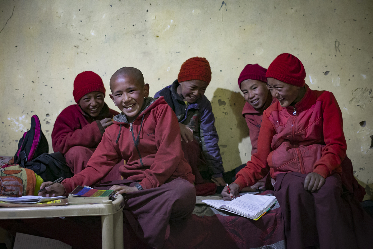 "LADAKH, INDIA - JUNE 13:  Students joke around while they study in their dorms at the Shachukul Monastery school, which is reliant on solar energy, in Chosling village on June 13, 2017 in Ladakh, India. Speaking two days after US President Donald Trump announced plans to withdraw from the Paris agreement on climate change, Indian Prime Minister Narendra Modi said that India was ""part of the world's shared heritage"" and that India would ""continue working...above and beyond the Paris accord"". India saw nearly $10 billion invested, both in 2015 and in 2016, in renewable energy projects.  (Photo by Allison Joyce/Getty Images)"