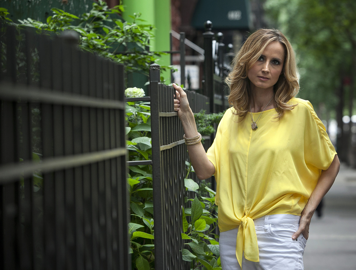 Country music singer Chely Wright poses for a portrait along the sidewalk in the Hells Kitchen neighborhood in New York