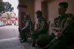 Police guard a Hindu temple in Bangladesh.
