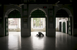 A man worships at the Hussaini Dalan Shia shrine in Dhaka, Bangladesh. On October 24th 2015 three bombs were thrown at the Hussaini Dalan Shia shrine during a large gathering, killing one and injuring over 100 more. ISIS claimed responsibility for the attack.