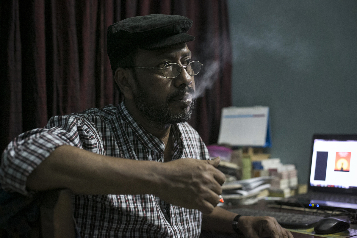 Blogger and author Ranadipan Basu smokes a cigarette in an unspecified city in Bangladesh. Basu was stabbed 9 times last year on the same day of the attack that killed Avijit Roy's publisher, Faisal Arefin Deepan, and left two other writers severely injured. Basu received many threats on facebook before the attack, and the police have since advised him to limit his movements, not travel alone, and limit his time in any unknown location to under 10 minutes. Now he always feels nervous about his security and he says {quote}I want a free life. I want to write freely.{quote} Ansar al-Islam, the Bangladesh division of Al Qaeda in the Indian subcontinent, claimed responsibility for the attack.