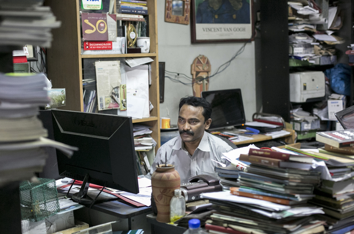 Liberal publisher Robin Ahasan works in his office in Dhaka, Bangladesh. Ahasan has been threatened three times for his work, once received a white burial shroud in the mail, and other times receiving letters addressed to the {quote}Enemy of Islam{quote} that read {quote}Your reward for publishing this material is death, and we shall deliver it at anytime{quote}. The police gave him a bodyguard for a short time but now he tries to protect himself by varying his routine. He says that {quote}They can get me anytime or anywhere, there is no point in stopping my life and work over these threats{quote}.