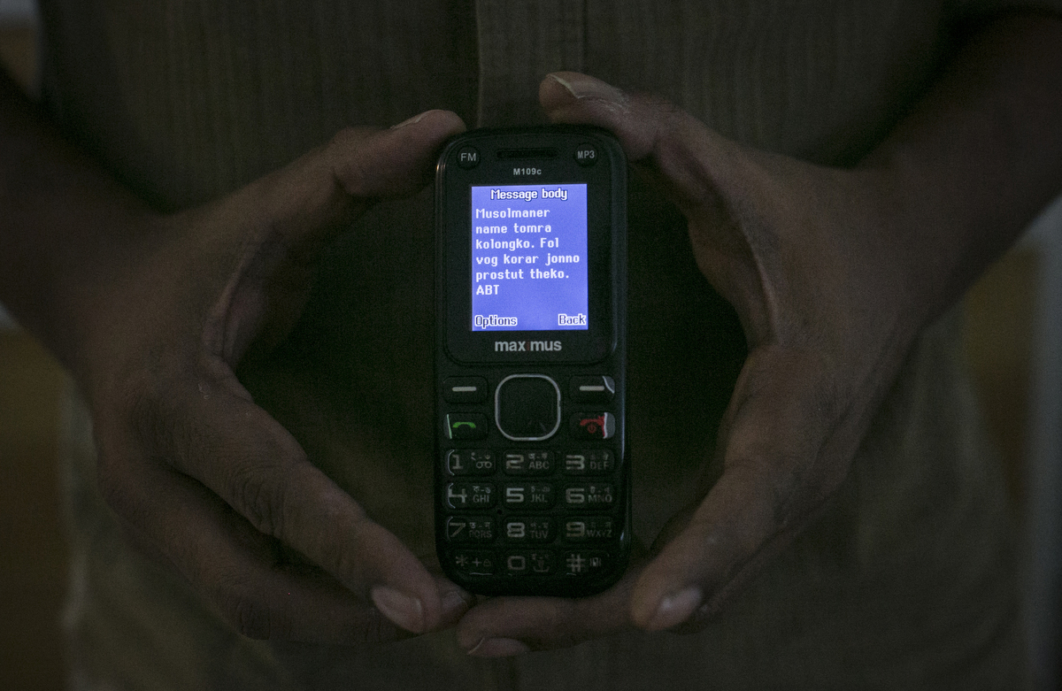 Activist Baki Billah holds a text message he received that reads {quote}You are a stain on the name of Islam. Be prepared for the final sentence.{quote} in Dhaka, Bangladesh. Billah was an activist during the Shahbag movement and has written and spoken out against Islamic fundamentalism. Since receiving the threats he has tried to avoid writing about Islam, always changes his routine, and never travels alone. Sometimes he is worried and scared, but he says he is used to living with the fear now.