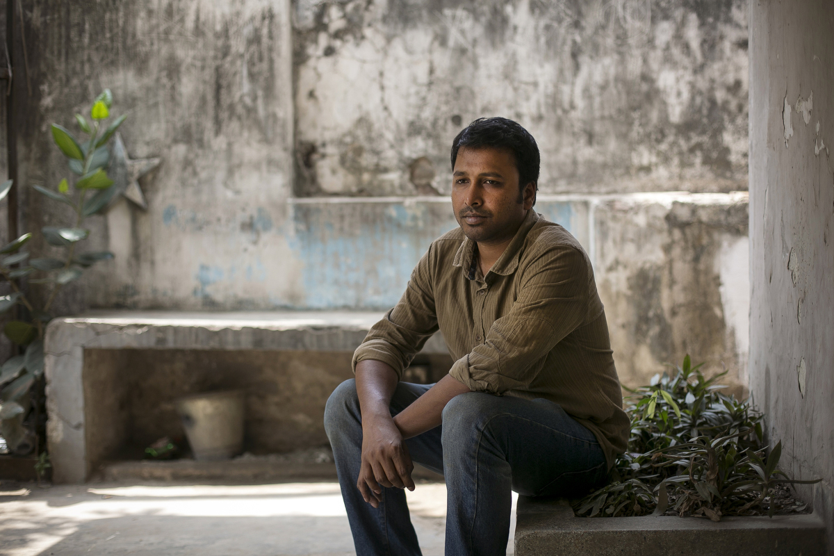 Activist Baki Billah poses for a photo in Dhaka, Bangladesh. Billah was an activist during the Shahbag movement and has written and spoken out against Islamic fundamentalism. He has received threats, including a text message that reads {quote}You are a stain on the name of Islam. Be prepared for the final sentence.{quote}.