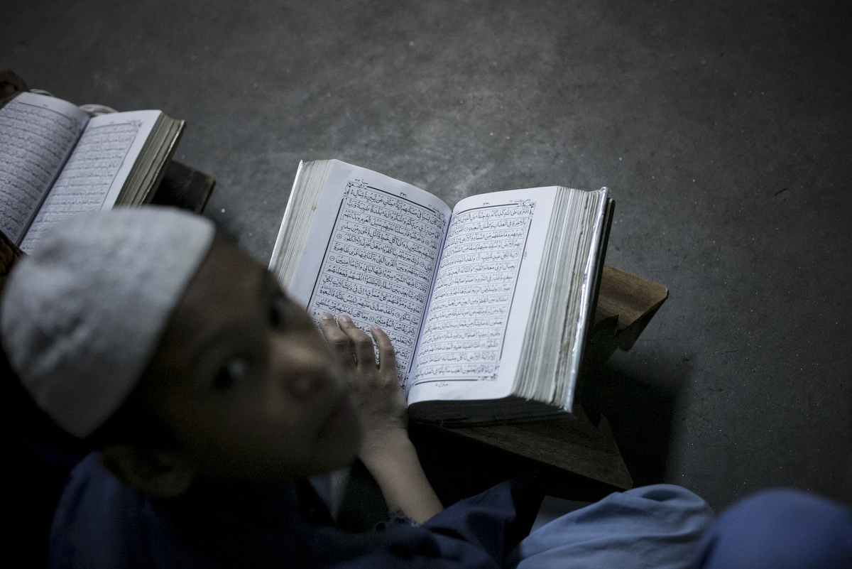 A boy studies at the Jamia Rahmania Arabia madrassa, where Mufti Jasim Uddin Rahmani who is the the spiritual leader of the Islamic militant group, the Ansarullah Bangla Team, used to teach, in Dhaka, Bangladesh. Rahmani is remembered as the {quote}jihadist cleric{quote} at the Hatembagh Jame Masjid where he led prayers and at the Jamia Rahmania Arabia madrassa where he used to teach. The Ansarullah Bangla Team, whom Al-Qaida has publicly praised, has been blamed for a series of murders of bloggers and activists in Bangladesh.