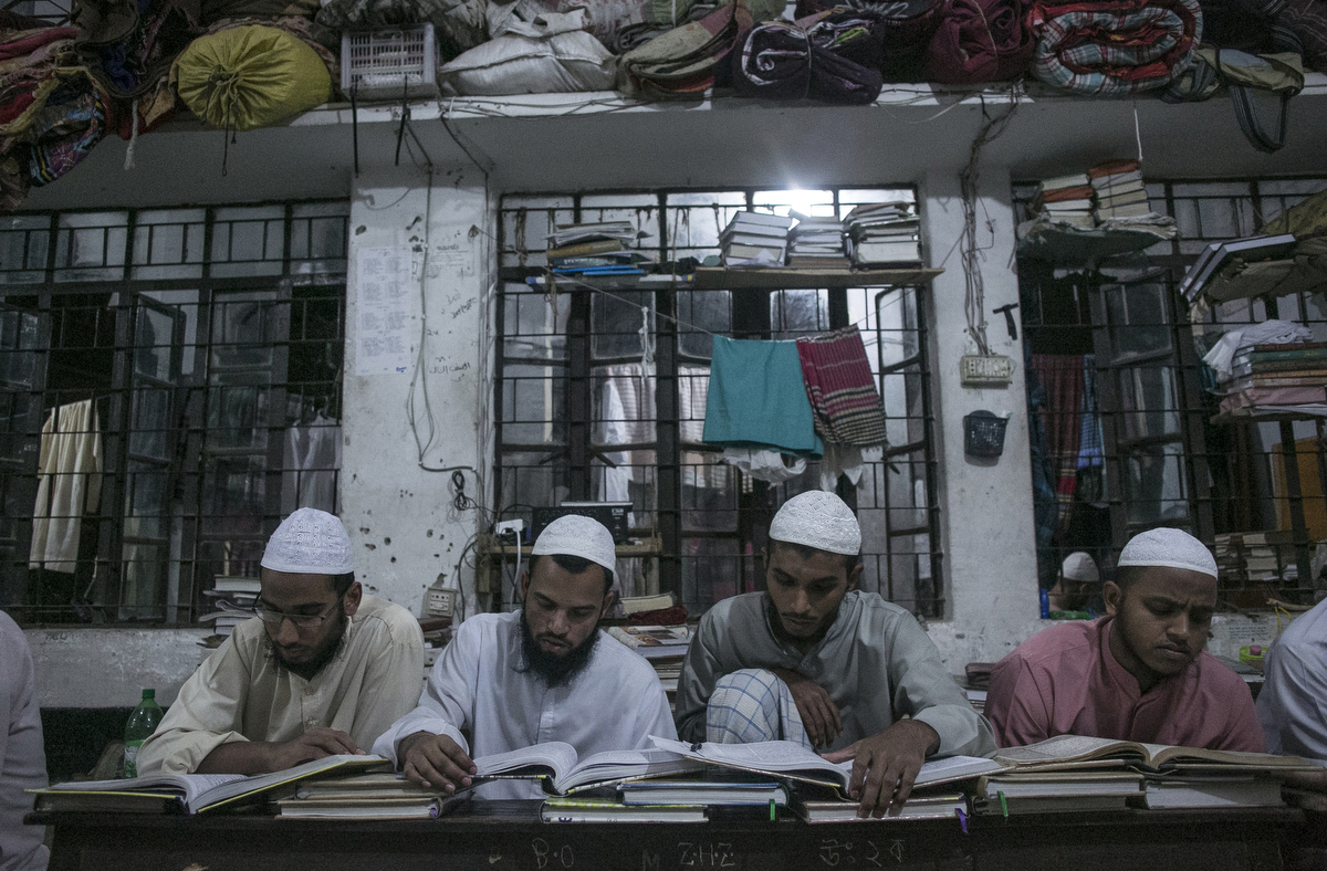 Men study at the Jamia Rahmania Arabia madrassa, where Mufti Jasim Uddin Rahmani who is the the spiritual leader of the Islamic militant group, the Ansarullah Bangla Team, used to teach, in Dhaka, Bangladesh. Rahmani is remembered as the {quote}jihadist cleric{quote} at the Hatembagh Jame Masjid where he led prayers and at the Jamia Rahmania Arabia madrassa where he used to teach. The Ansarullah Bangla Team, whom Al-Qaida has publicly praised, has been blamed for a series of murders of bloggers and activists in Bangladesh.