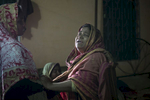 Ambia Begum, wife of Christian convert Hossain Ali, who was murdered by ISIS, cries in her home in Kurigram, Bangladesh. On March 22 Ali was taking his usual morning walk when he was attacked and died. Ali was a Navy Commander during Bangladesh's 1971 Liberation War, and converted to Christianity 16 years ago. The police warned him and his family to be careful and limit their movement because of the ongoing security issues, but Ali felt safe since he said he had no enemies. ISIS claimed responsibility for his murder. He is remembered as a gentle, simple and happy man, and he leaves behind a wife, mother, and three children.