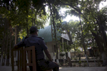 A police guards a church who's Reverend received death threats from ISIS in Bangladesh