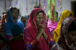 A woman cries during a church service led by Reverend Barnbash, who has received death threats from ISIS, in Bangladesh.
