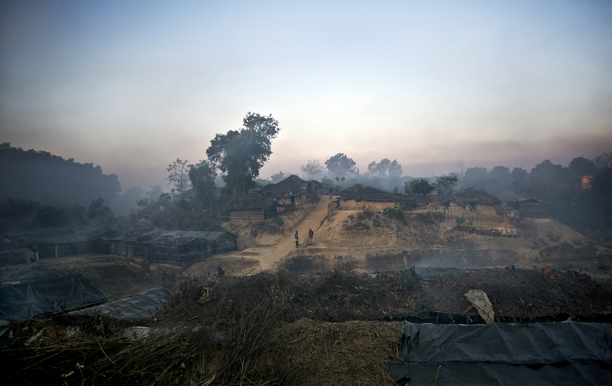 Smoke from cooking fires and early morning mist hangs in the air above Kutapalong Rohingya refugee camp.