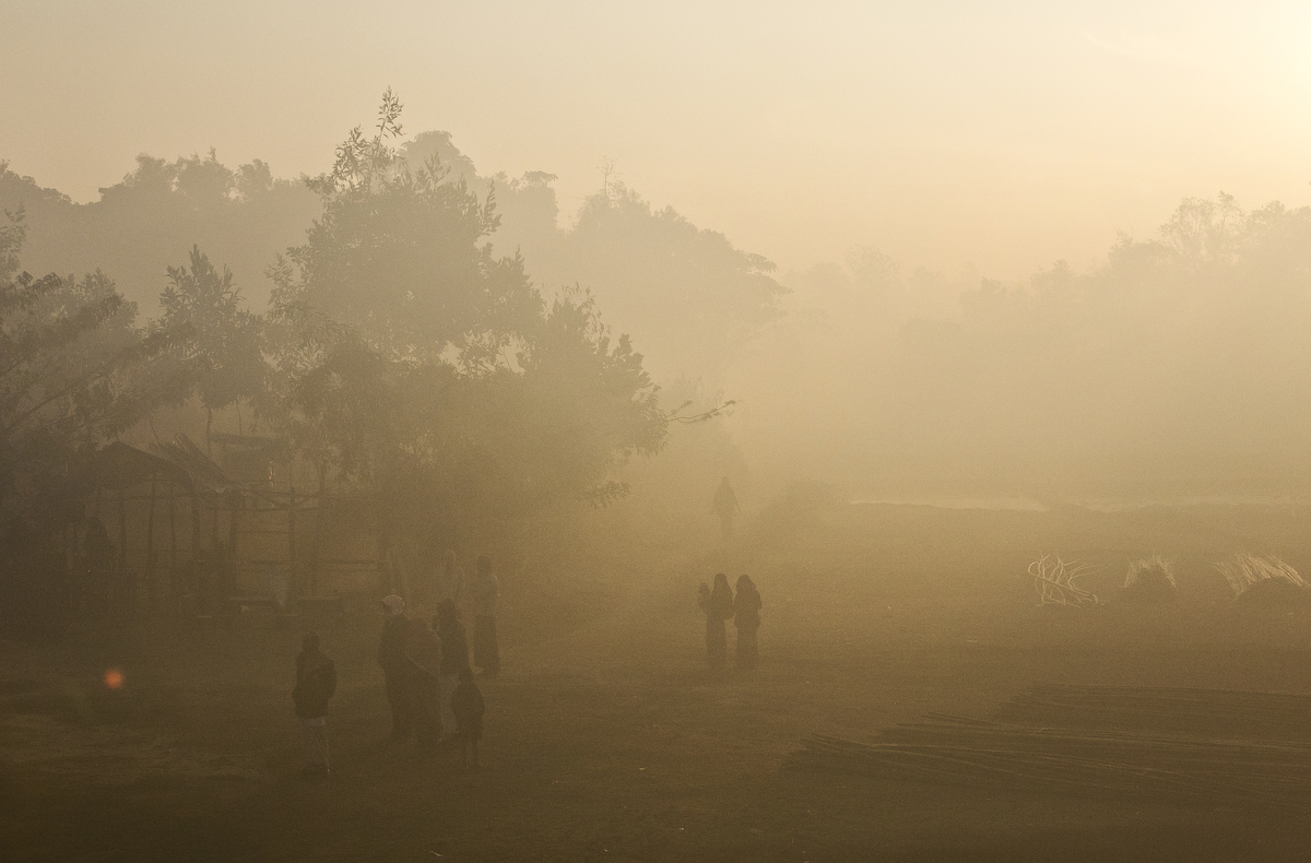 Rohingyas walk through early morning mist in the Balu Kali refugee camp in Bangladesh