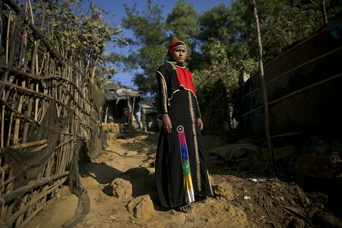 Jamalida poses for a photo in 2017 in Kutalong Rohingya refugee camp in Cox's Bazar, Bangladesh. Jamalida, who is 16 years old, came to Bangladesh 1 month ago from Shilkhali village in Myanmar. She says that one day in December the military moved into her village and started occupying the mosque and beating or killing whoever came in. {quote}One day they attacked our home. I wasn't able to flee in time and they caught me and tied my hands and legs with rope. For 3 hours, 4 soldiers took turns raping me until I lost consciousness.{quote} When she woke up she fled to Bangladesh, where she made her way to Kutalapong refugee camp. {quote}I never had peace in Burma and this last incident was horrible. Here, I feel peace. I can sleep well here, I can go outside safely. In Burma, I couldn't go outside and I wasn't safe in my home. We don't have enough food here, but at least we have peace.{quote} she says {quote}Every night when I sleep I have nightmares and I relive the rape again""