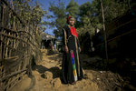 """Jamalida poses for a photo in 2017 in Kutalong Rohingya refugee camp in Cox's Bazar, Bangladesh. Jamalida, who is 16 years old, came to Bangladesh 1 month ago from Shilkhali village in Myanmar. She says that one day in December the military moved into her village and started occupying the mosque and beating or killing whoever came in. {quote}One day they attacked our home. I wasn't able to flee in time and they caught me and tied my hands and legs with rope. For 3 hours, 4 soldiers took turns raping me until I lost consciousness.{quote} When she woke up she fled to Bangladesh, where she made her way to Kutalapong refugee camp. {quote}I never had peace in Burma and this last incident was horrible. Here, I feel peace. I can sleep well here, I can go outside safely. In Burma, I couldn't go outside and I wasn't safe in my home. We don't have enough food here, but at least we have peace.{quote} she says {quote}Every night when I sleep I have nightmares and I relive the rape again"""""""