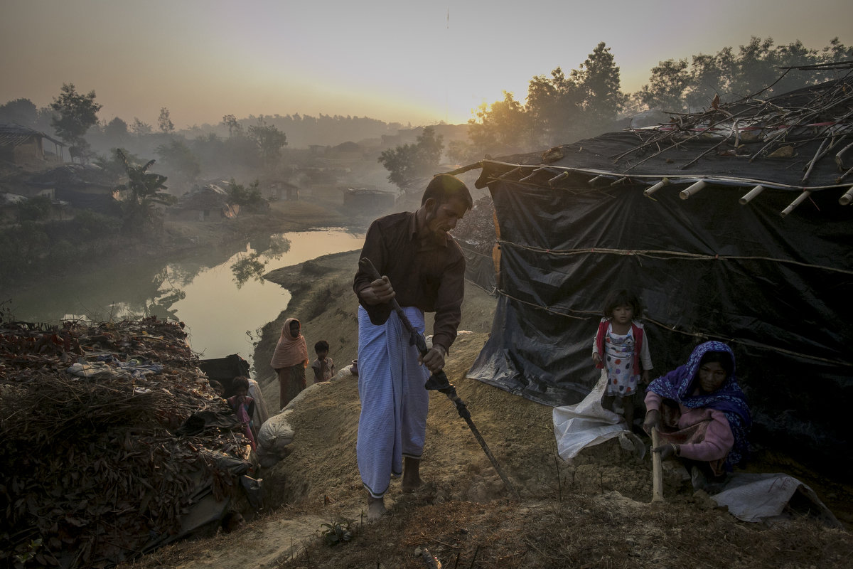 Abdul Shukor works on his home in Kutapalong Rohingya refugee camp in 2017 in Cox's Bazar, Bangladesh. Shukor fled to Bangladesh 2 months ago from Rasidon village after the military attack to their village. The military cut the throat and killed his 18 year old son before his eyes.
