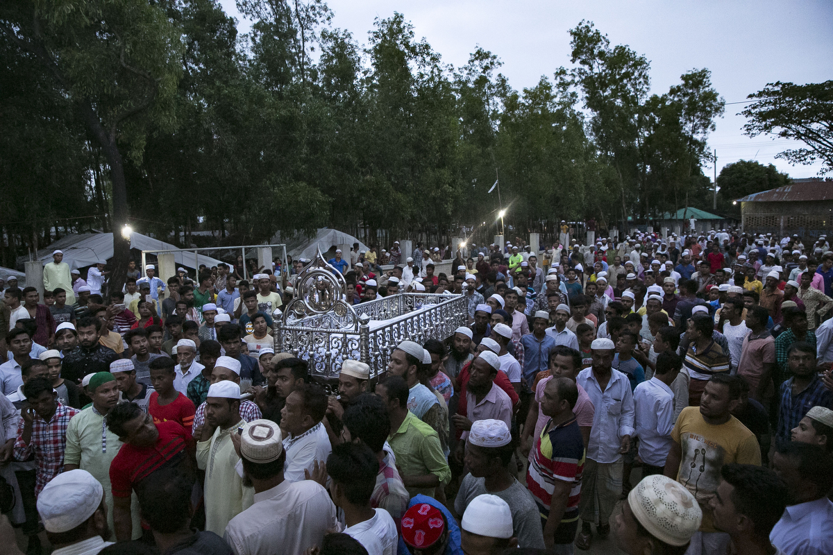 The funeral for Omar Faruk is seen near Nayapara Rohingya refugee camp on August 23, 2019 in Cox's Bazar, Bangladesh. Hundreds of Bangladeshis blocked a highway and stormed a Rohingya camp, vandalizing UN property, NGO offices and refugee shelters following the murder of Omar Faruk. Faruk, the leader of the youth wing of Bangladesh's ruling Awami League, the Jubo League, was allegedly shot dead by Rohingyas on Thursday night. In response, UN missions to the southern Rohingya refugee camps have been postponed until further notice. August 25th marks the second anniversary of the Rohingya crisis in Bangladesh. Myanmar's military crackdown on the ethnic Muslim minority forced over 700,000 to flee to Bangladesh from violence and torture. The United Nations has stated that it is a textbook example of ethnic cleansing. (Photo by Allison Joyce/Getty Images)