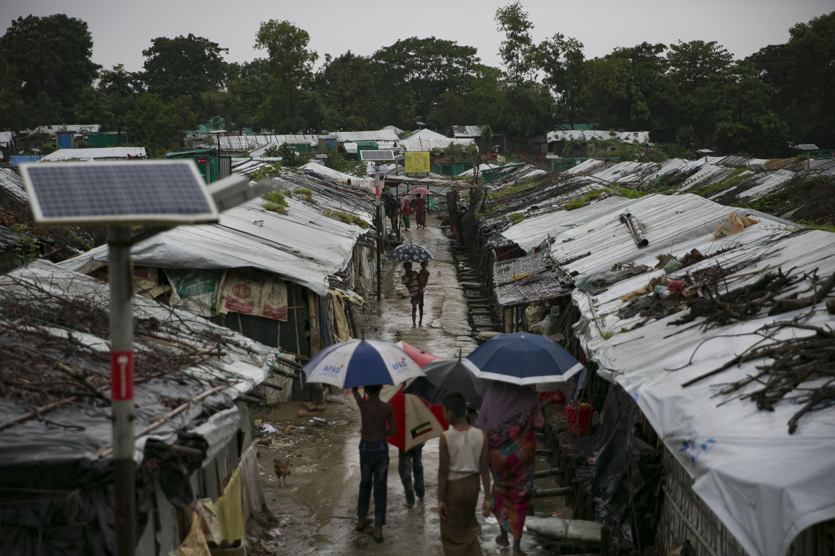 Rohingya are seen in a refugee camp