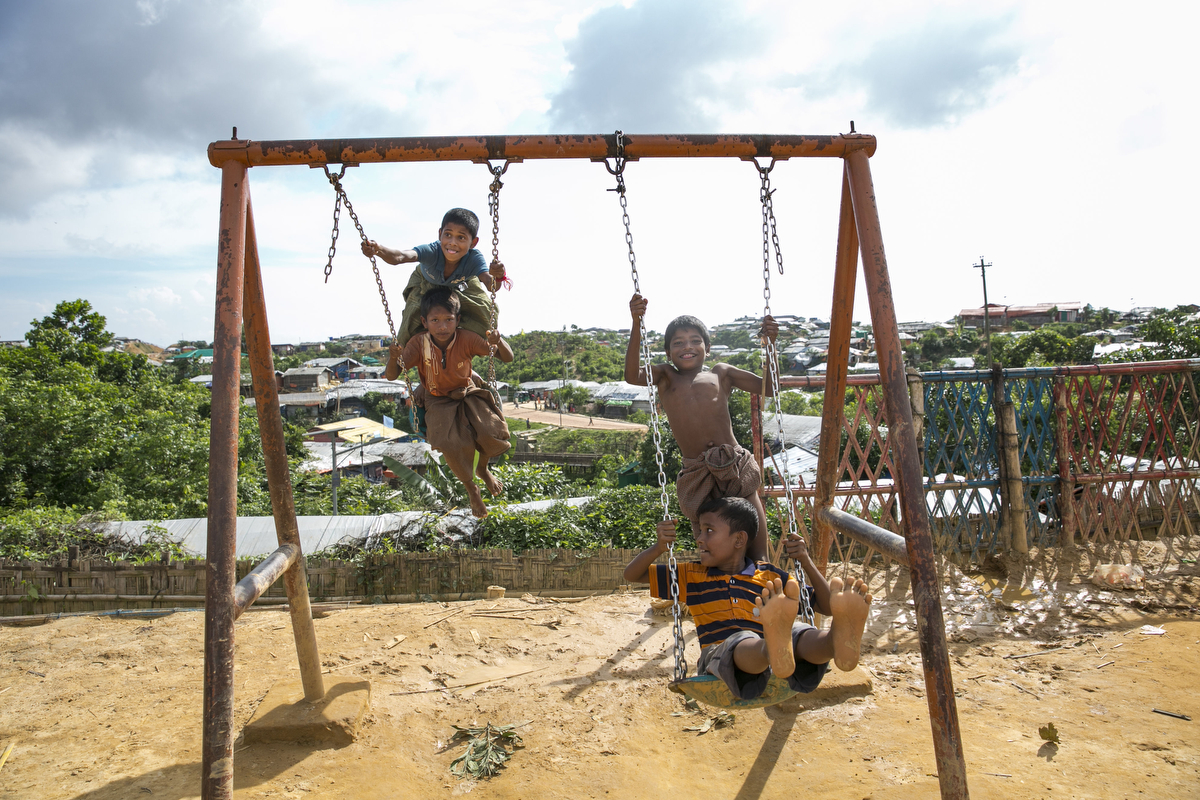 Kids swing in the camp