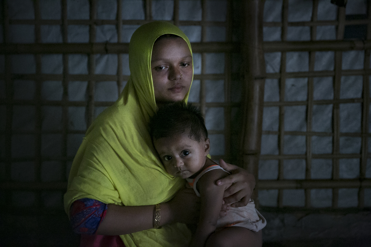Yasmin Akhter, is a 14 year old wife and mother. She came to Bangladesh when she was 8 years old. She never had the chance to go to school. Her father left the family and left her mother, 40 old NurNahar Begum, and two years after she fled from Myanmar to Bangladesh she was sent to Chittagong to work as a housekeeper for a family of 5. She worked there for two years, never receiving a formal salary, getting only 200 or 300 taka occasionally. The mother that she worked for beat her frequently. She wasn't allowed to go outside, but Yasmin stayed thinking that it was the only way she could help her family.  One day she couldn't take any more and she called her mother and told her about the abuse, and said if she stayed there one more day she would die. Her mother brought her back to the refugee camp and arranged for her to get married. Yasmin was 12 years old when she married her 30 year old husband. When Yasmin was married she was happy, she thought that her husband would provide a better life for her, but he is sick and unable to work, and their food rations from the NGOs are not enough. 9 months ago Yasmin gave birth to a baby girl. She dreams of a better life for her daughter, one where she is independent, educated, and works a respected job. {quote}It will be up to her when she gets married{quote} Yasmin says. NurNahar Begum says {quote}I didn't have any choice, that's why I had to make this decision. I took two wrong decisions for her life. The first one sending her to Chittagong to work as a maid and the second one in getting her married. I didn't know it would turn out like this. I always tried to give my kids a good life but I failed. We never had enough food, no good shelter, they were never able to get an education. I failed.{quote}