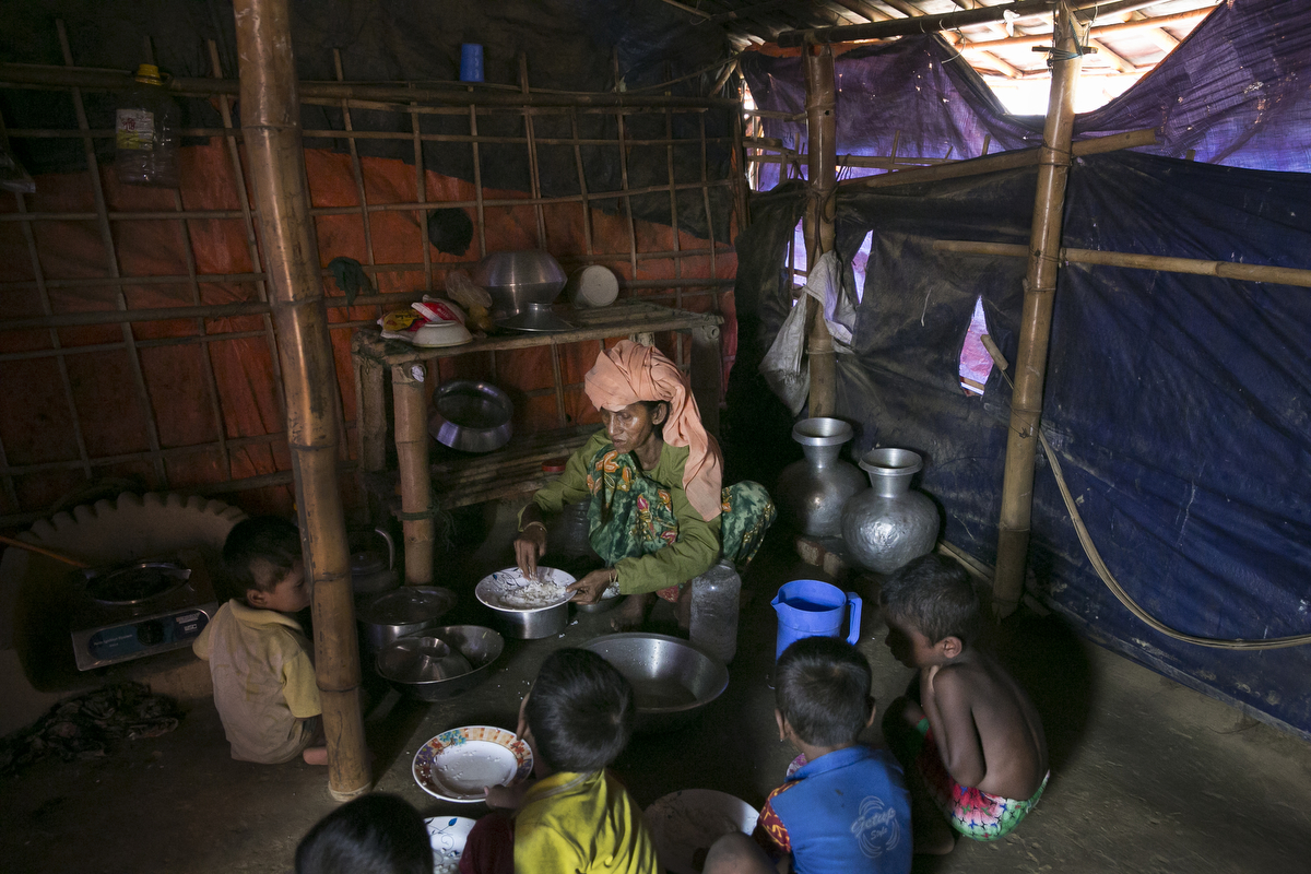 Salema Khatum cooks for relatives in the widows camp. In the refugee settlement of Balukhali, over 116 widows, orphans, and women who have been separated from their husbands have found shelter within a dense settlement of 50 red tents where no men or boys over the age of 10 years old are allowed.